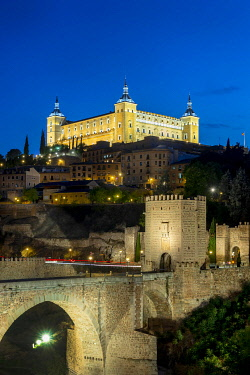IBXSKI05105710 Bridge Gate, Alcantara Bridge, Puente del Alcantara, over the river Tajo, with Alcazar de Toledo, night view, Toledo, Castilla-La Mancha, Spain, Europe