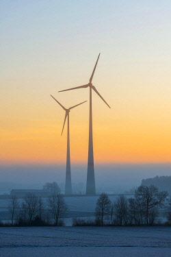 IBXTKE05099803 Wind power plants, silhouettes in dawn, Swabian Alb, Baden-Wurttemberg, Germany, Europe