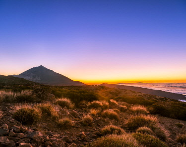 IBXVFW04506256 Sunset, sunset glow with evening star, cloudy sky, Volcano Teide and volcano landscape, backlit scenery, national park El Teide, Tenerife, Canary Islands, Spain, Europe