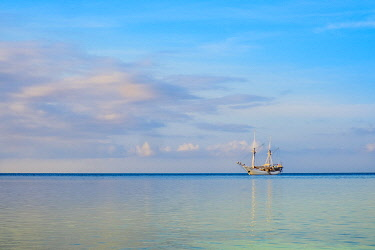 IDA1084AW Asia, Indonesia, Spice Islands, Maluku, a traditional Lamba (or lambo) Pinisi sailing ship on the Indian ocean. Pinisi are Buginese wooden ships. UNESCO designated Pinisi boat-building art as a Master...