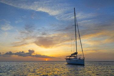 CA19BJY0025 Caribbean, Grenada, Mayreau Island. Sailboat at anchor at sunset