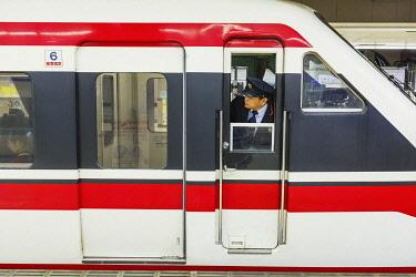 TPX73186 Japan, Honshu, Tokyo, Asakusa Station, Tobu Railways, Train Guard