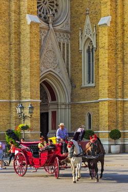 EU37KSU0195 Horse carriage with the Name of Mary Church in Liberty Square, Novi Sad, Serbia.