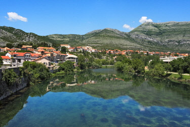 EU44KSU0134 Old town by Trebisnjica River with reflection in the water, Trebinje, Bosnia.