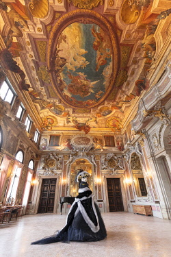 ITA15144AW A woman poses in costume during the Venice Carnival inside an ornate palace,  Venice; veneto; Italy