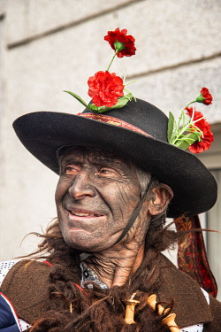 POR10880AW At the Winter Solstice Festivities in Vila Ch�A? de Braciosa, the Velha character (the Old Woman) is painted black and carries a stick with several pork bladders. Miranda do Douro, Trás-os-Montes. Po...