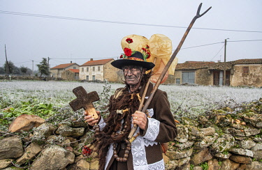POR10881AW The Winter Solstice Festivals in Vila Ch�A? de Braciosa. The character Velha (the Old Woman) is painted black and carries a cross of burnt cork to dirty those who do not give alms. Miranda do Douro, T...