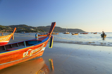 THA1466AW Long tail boats on Kata Beach, Phuket, Thailand