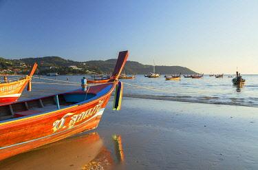 THA1466AW Long tail boats on Kata Beach, Phuket, Thailand