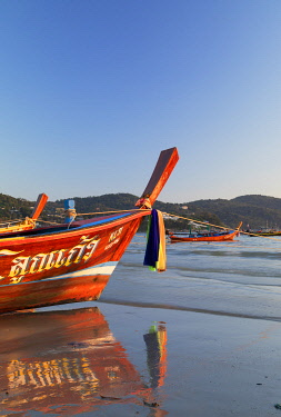 THA1469AW Long tail boats on Kata Beach, Phuket, Thailand
