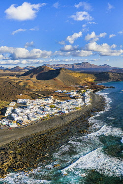 ES274RF Spain, Canary Islands, Lanzarote, aerial view of El Golfo village and  the volcanic landscape of Timanfaya National Park and the Volcanos Natural Park