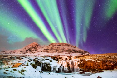 ICE4233AW Aurora Borealis over Kirkjufell Waterfall, Snaefellsnes National Park, Snaefellsnes Peninsula, Iceland, Europe
