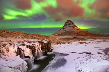 ICE4237AW Aurora Borealis over Kirkjufell Waterfall, Snaefellsnes National Park, Snaefellsnes Peninsula, Iceland, Europe