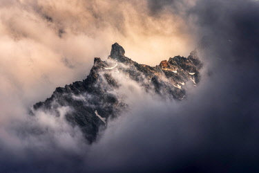 FRA11815AW Peaks of the Alps appearing during a storm clearing, Alps, France
