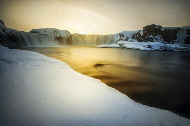 ICE42299AW Godafoss waterfall during a cold sunset in winter, Nordurland, Iceland
