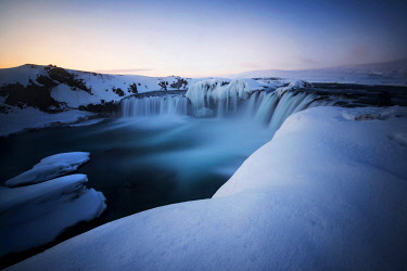 ICE42302AW Godafoss waterfall during a cold sunrise in winter, Nordurland, Iceland