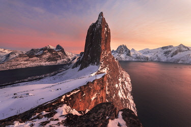 NOR1156AW Segla mountain rising above the fjord during a winter sunset, Senja island, Norway