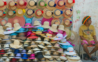SA06KSU0036 Vendor selling hat on the street in the old town, Cartagena (UNESCO World Heritage Site) Bolivar Department, Colombia.