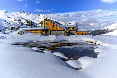IBLMMW05122267 Snowy Lizumer Hut with small mountain lake in winter, Wattentaler Lizum, Tuxer Alps, Tyrol, Austria, Europe