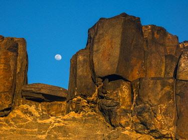 IBXYUC05126786 Moonrise between stones, Fuerteventura, Canary Islands, Spain, Europe