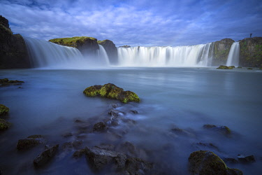 ICE42364AW Beautiful Godafoss waterfall against cloudy sky, Northern Iceland, Iceland