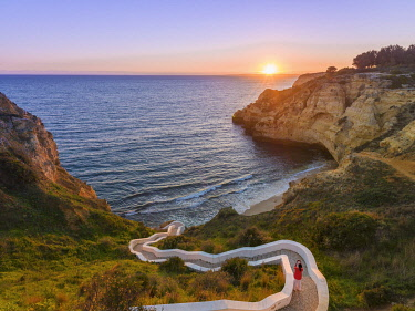 POR10924AW Portugal, Algarve, Lagoa, carvoeori, steps leading to beach at sunset (MR)