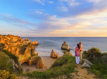 POR10940AW Portugal, Algarve, Alvor, Prainha, Man and woman at overview (MR)