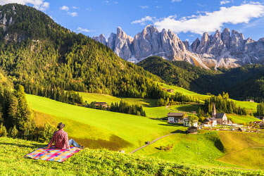 ITA15383AW Man enjoying the view over St. Magdalena in Autumn, Val di Funes, Dolomites, South Tyrol, Italy (MR)