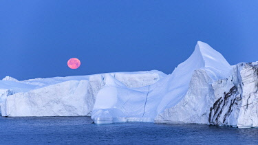 GRN1383 Moon setting over icebergs in Kangia Icefiord