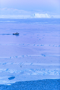 GRN1403 Fishing boat cutting through the Kangia Icefiord near to Ilulissat