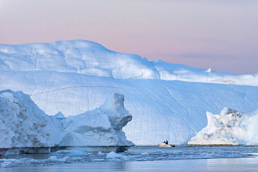 GRN1418 Fishing boat necogiates its way through icebergs in the Kangia Ice fiord