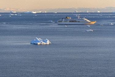 GRN1421 Cruise ship arrives in Disko Bay at sunset