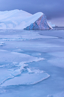 GRN1441 Sun setting on icebergs in the Kangia Icefiord, Ilulissat