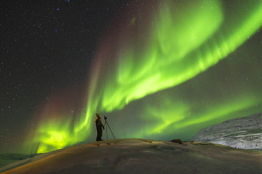 GRN1458 Photographing the Northern Lights (Aurora Borealis), Oqaatsut, West Greenland