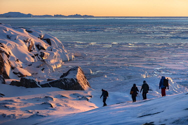 GRN1462 Walkers on the ice coast of West Greenland