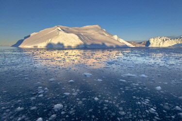 GRN1468 Sun setting on icebergs in the Kangia Icefiord, Ilulissat