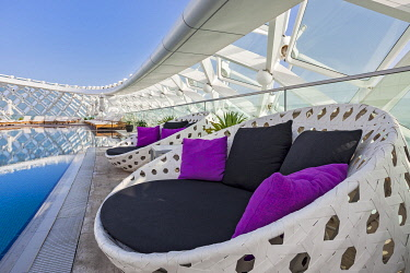 Pool side seating at the rooftop pool deck of the Yas Viceroy Abu Dhabi hotel, Abu Dhabi, Abu Dhabi Emirate, United Arab Emirates.
