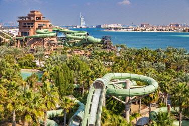 UAE870 Panoramic view towards the Burj Al Arab, the Palm Jumeirah and the Aquaventure Waterpark Atlantis Resort and waterslide, The Palm Jumeirah, Dubai, United Arab Emirates.