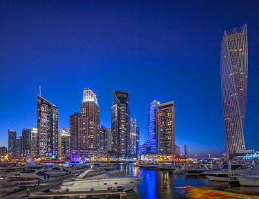 UAE871 Dubai Marina at twilight with the Cayan Tower (Infinity Tower) and various residential towers, Dubai Marina, Dubai, The United Arab Emirates.