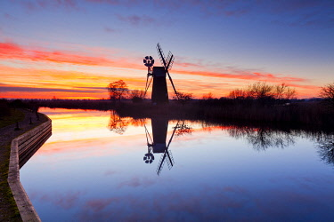 ENG16753AW Turf Fen Mill Reflecting in the River Ant, How Hill, Norfolk Broads National Park, England