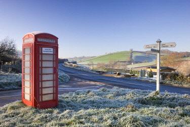 ENG16725AW Traditional English telephone box in the frost at Stockleigh Pomeroy, Devon, England