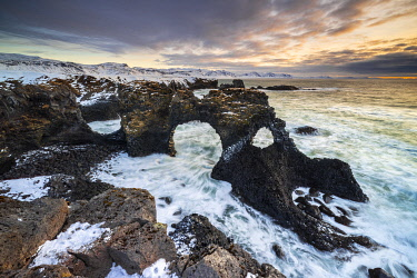 CLKMB128168 Gatklettur arch at sunrise, Arnarstapi, Hellnar,  Snaefellsnes Peninsula, Iceland
