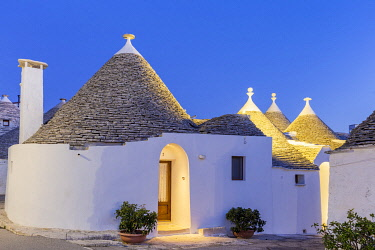 CLKFB124477 Traditional trullo house at dusk. Unesco World Heritage Site, Alberobello, Province of Bari, Apulia, Italy