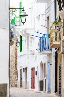 CLKFB124692 Narrow white street in the historic centre of Monopoli, Apulia, Italy
