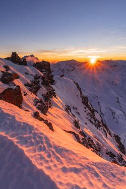 CLKGM129521 Last sunlight from Vallombrina mountain in the Stelvio National Park during a winter sunset. Vallombrina mount, Gavia pass, Santa Caterina Valfurva, Valtellina, Sondrio district, Lombardy, Italy