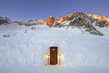 CLKMB122902 An igloo room of Capanna Presena at sunrise, Trento, Val Presena, Trentino Alto Adige, Italy