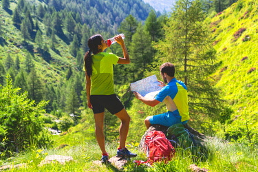 CLKMR126735 Pair of hikers on the Brescia trails, Valle Camonica, Ponte di Legno, Brescia province, Lombardy, Italy