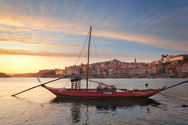 CLKDC124555 Port wine boats moored on the south bank of Douro River, Porto,  Portugal