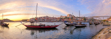 CLKDC124556 Port wine boats moored on the south bank of Douro River, Porto,  Portugal