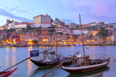 CLKDC124561 Port wine boats moored on the south bank of Douro River, Porto,  Portugal